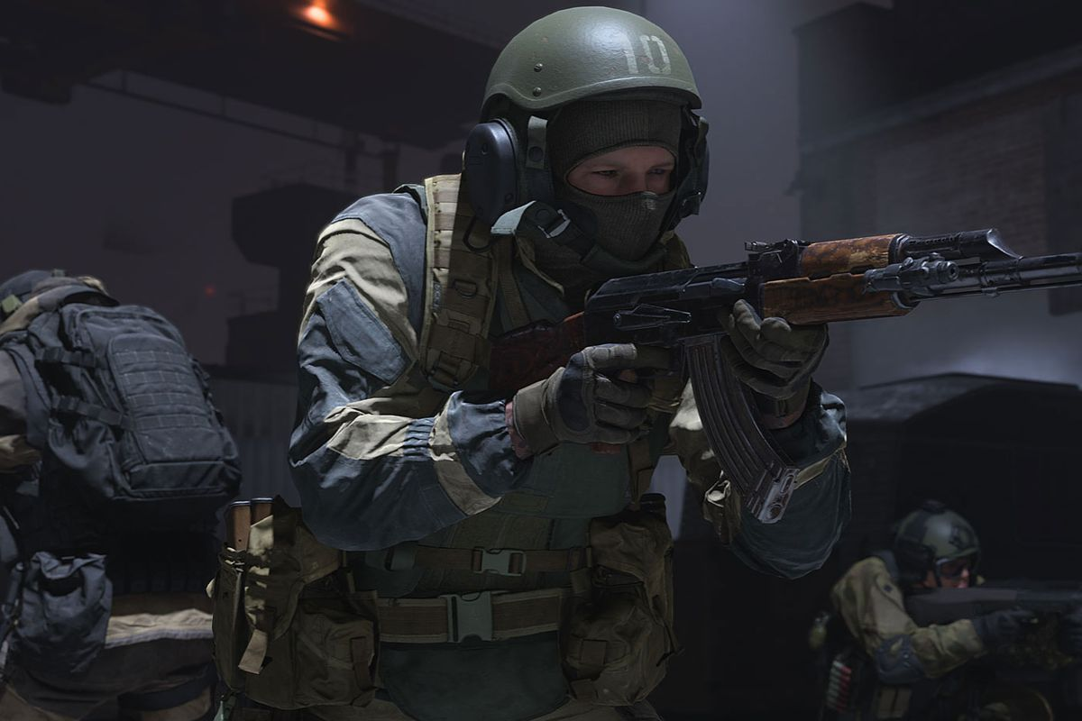 Three soldiers in Russian military gear secure an area in Call of Duty: Modern Warfare.