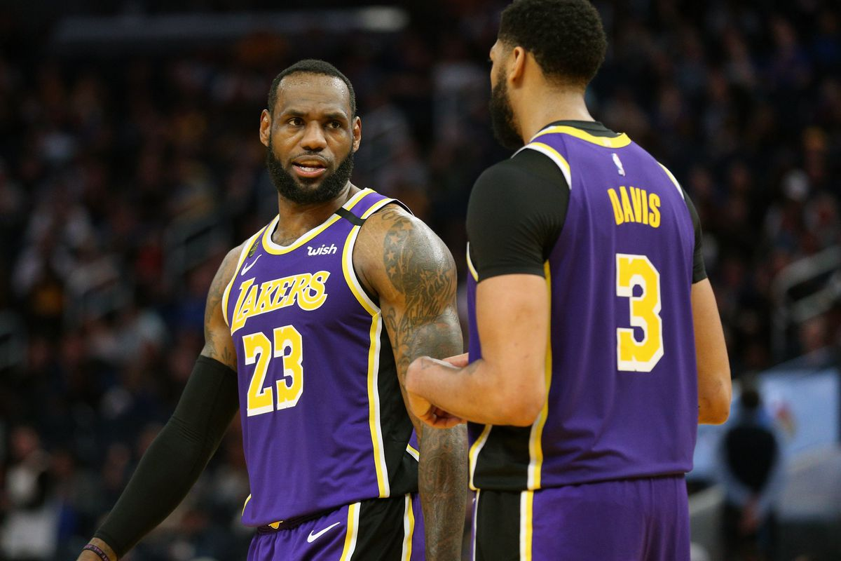 Los Angeles Lakers forward LeBron James talks with center Anthony Davis during a break in the action against the Golden State Warriors in the fourth quarter at the Chase Center.