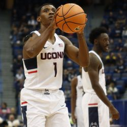 UConn's Christian Vital (1) attempts to complete the three-point play.