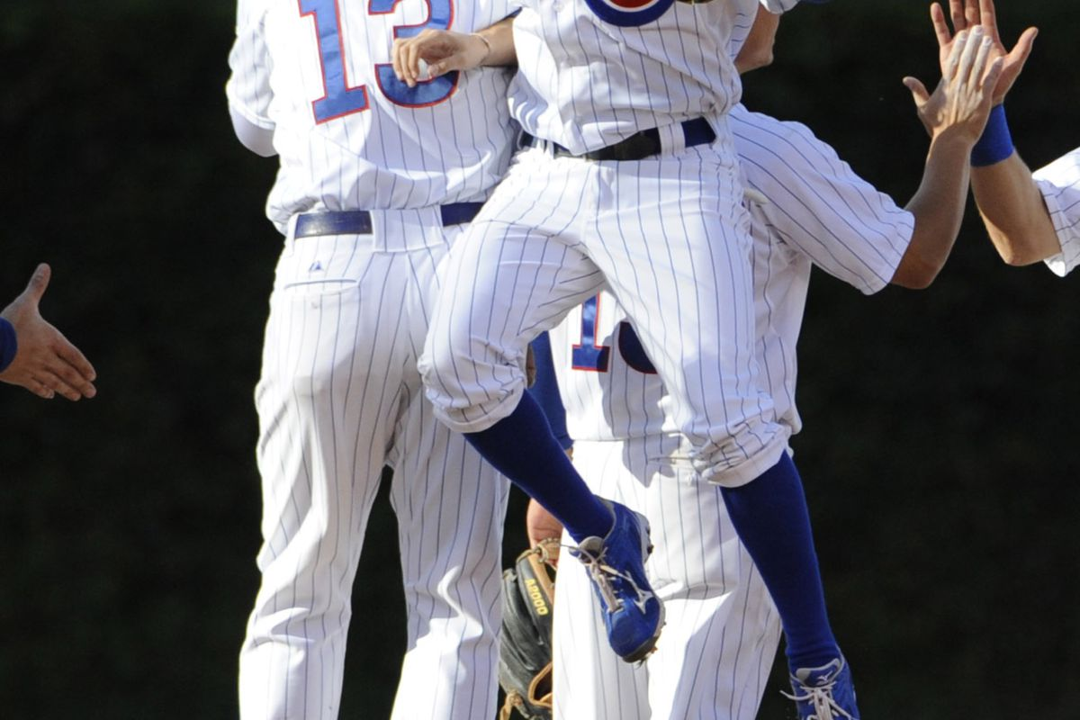 Starlin Castro of the Chicago Cubs and Tony Campana celebrate the Cubs win against the Pittsburgh Pirates at Wrigley Field in Chicago, Illinois. The Chicago Cubs defeated the Pittsburgh Pirates 7-4. (Photo by David Banks/Getty Images)
