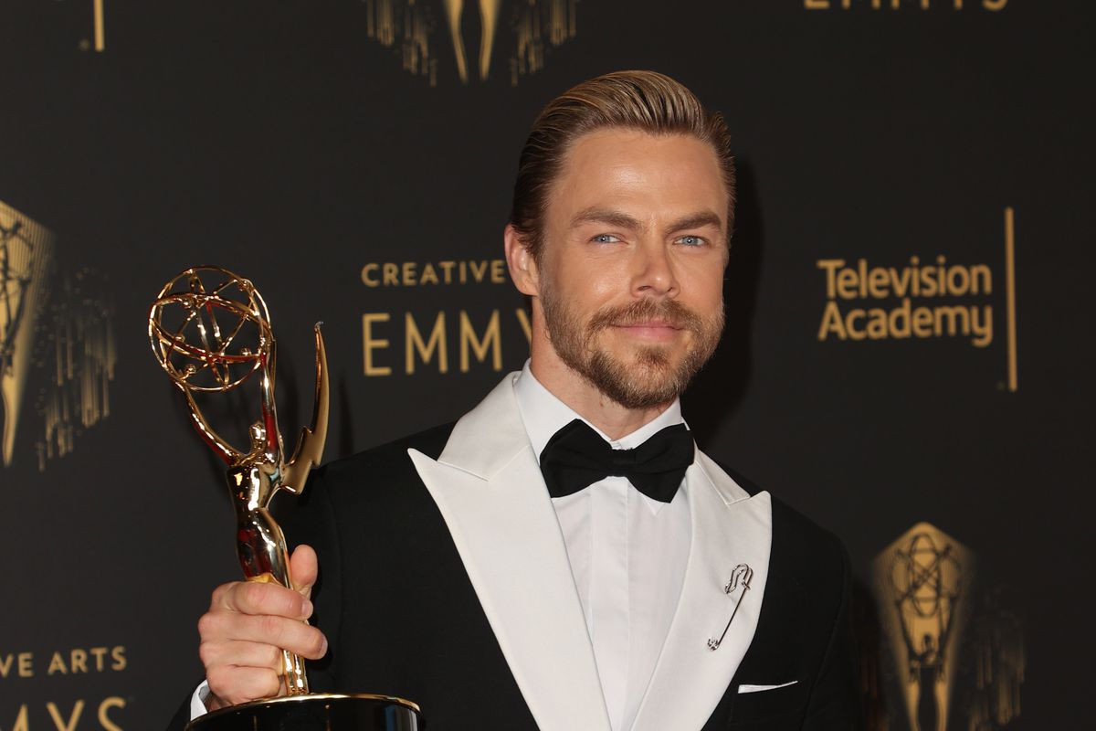 """Derek Hough poses with the award for outstanding choreography for variety or reality programming for """"Dancing With The Stars"""" at the Creative Arts Emmys at Microsoft Theater on September 12, 2021 in Los Angeles, California."""