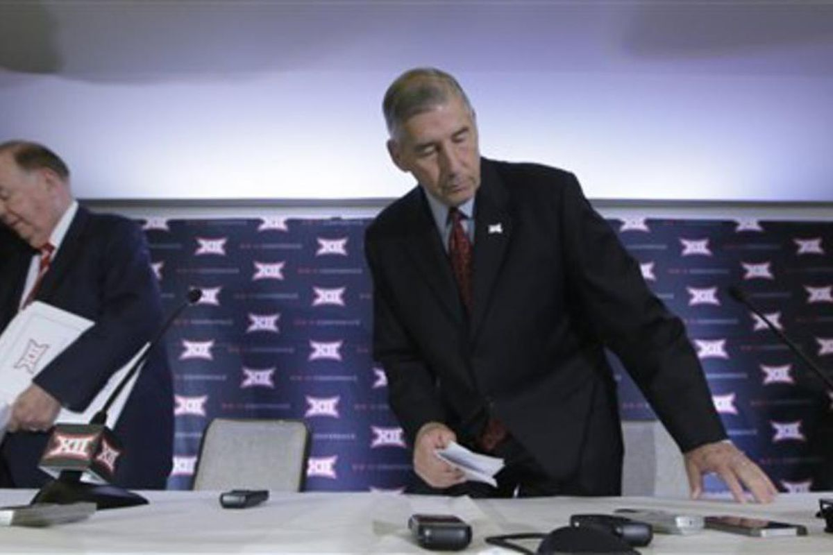 Commissioner of the Big 12 Bob Bowlsby, right, and University of Oklahoma President David Boren arrive to speak to reporters at the Big 12 sports conference meetings in Irving, Texas, Thursday, June 2, 2016. (AP Photo/LM Otero)