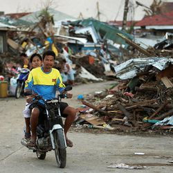 Damage from a typhoon is visible in Tacloban, Tuesday, Nov. 19, 2013.