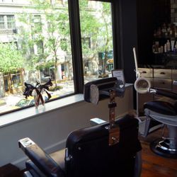 You can see Lexington Avenue from the men's grooming area, but you can't hear it.