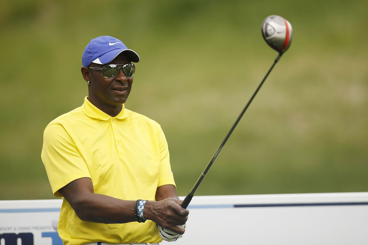Hall of Fame football player Jerry Rice prepares to hit a tee shot during the first round of ARIA Resort & Casino's 12th annual Michael Jordan Celebrity Invitational golf tournament at Shadow Creek on April 4, 2013 in North Las Vegas, Nevada.