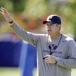 Brigham Young University coach Bronco Mendenhall runs  practice in Provo, Utah, Friday, Aug. 20, 2010.