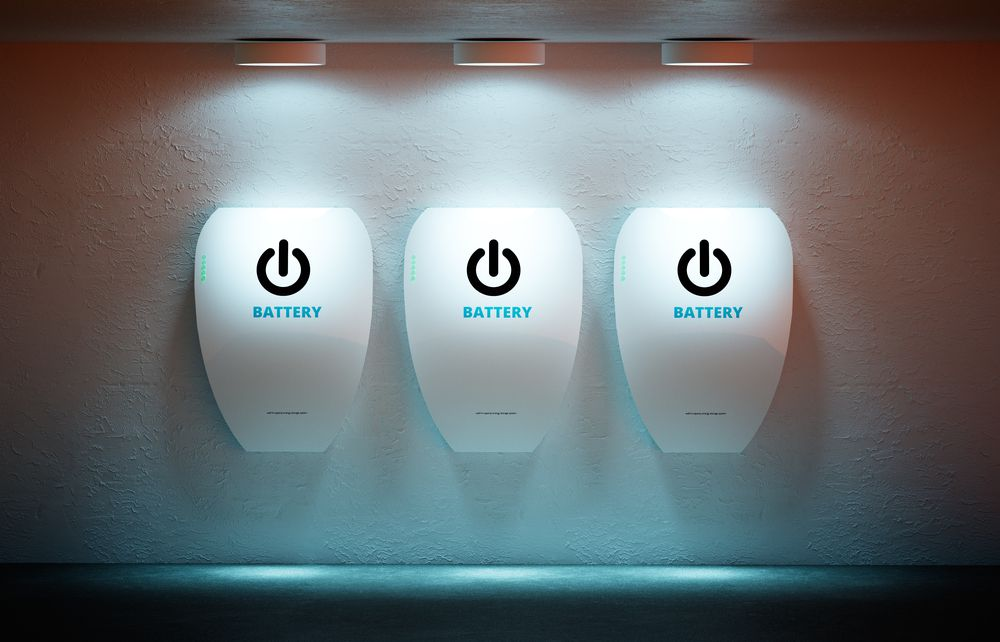 "Three wall batteries on a wall, each with the computer power symbol and the word ""battery."""