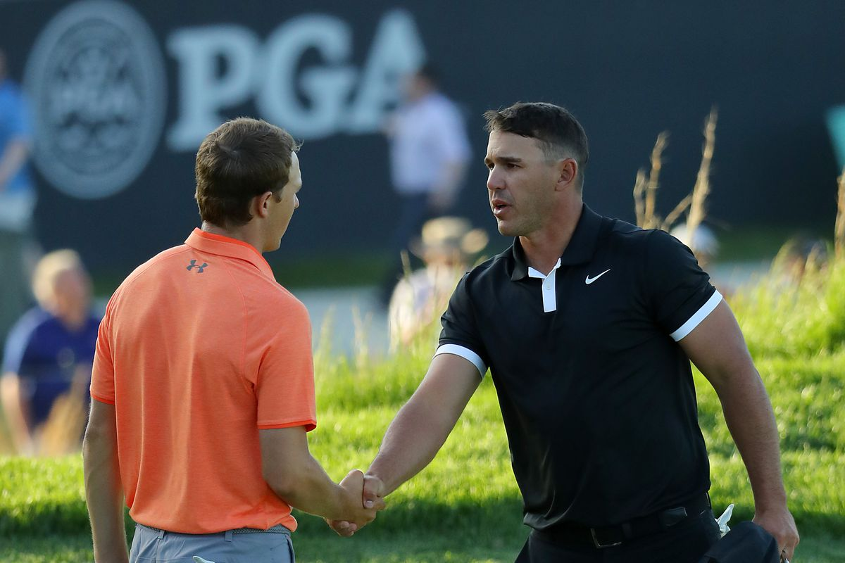 Jordan Spieth of the United States and Brooks Koepka of the United States shake hands on the 18th green during the third round of the 2019 PGA Championship at the Bethpage Black course on May 18, 2019 in Farmingdale, New York.
