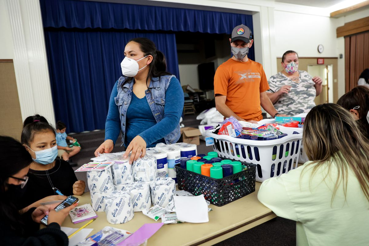 Cely Constanza, Young Women president for the Medford 7th Branch of The Church of Jesus Christ of Latter-day Saints, works with volunteers in Medford, Ore., on Tuesday, Sept. 22, 2020, to organize donations for migrant worker families affected by the Almeda Fire.