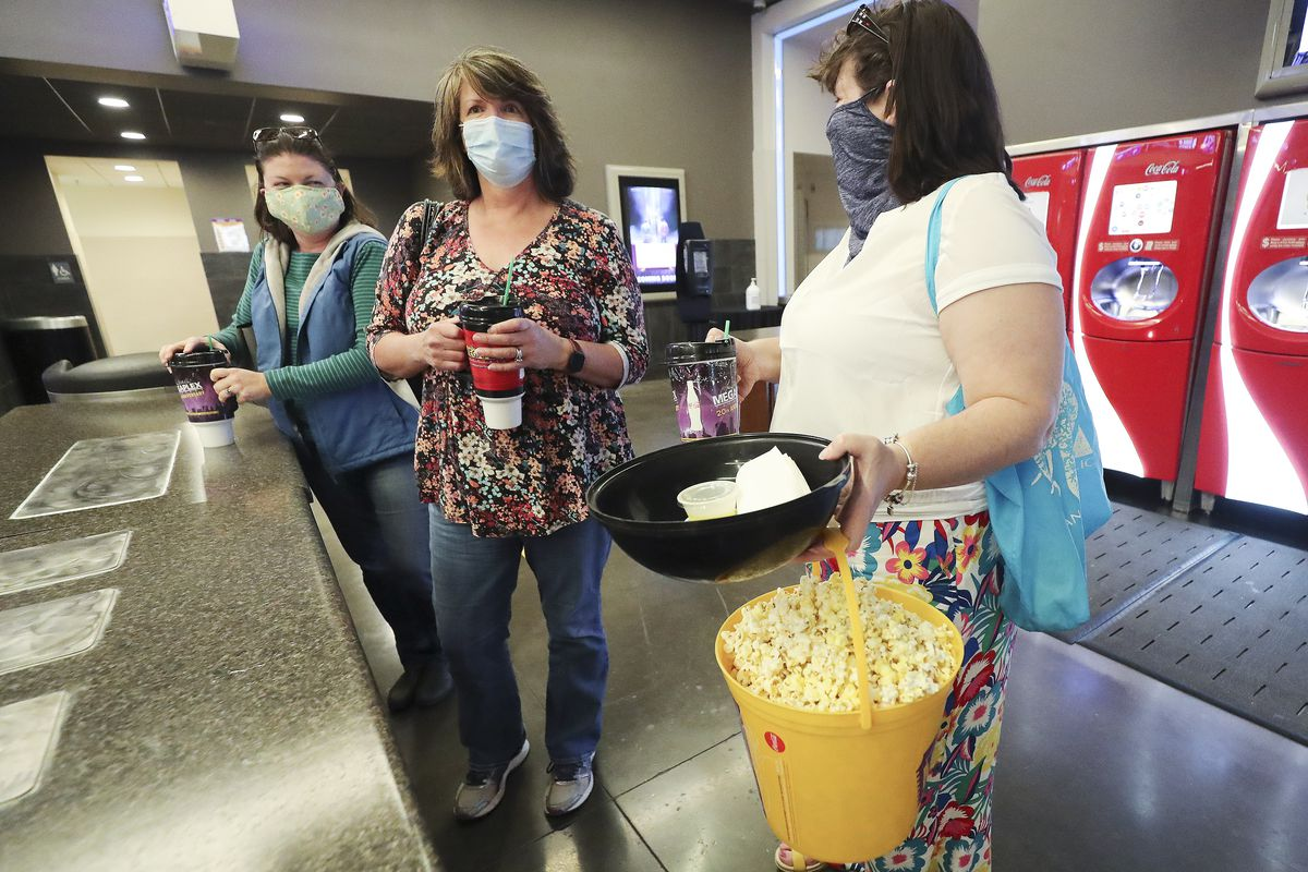 Karah Altman, left, Ann Crissman and Rebecca Armitage, get drinks and popcorn prior to a movie at the Megaplex Theatres at Valley Fair Mall in West Valley City on Thursday, June 18, 2020. After three months of temporary closure due to COVID-19 restrictions, Larry H. Miller Megaplex Theatres are resuming modified business operations.