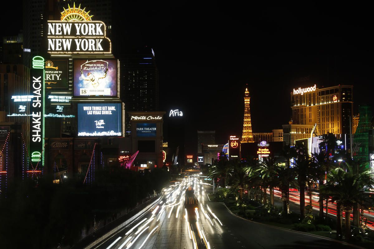 Some of the casinos along the Las Vegas Strip dim their marquees signs for about 10 minutes Sunday, Oct. 8, 2017, in Las Vegas, to pay tribute to the victims who spent that much time under fire in the Las Vegas shooting on Sunday, Oct. 1.