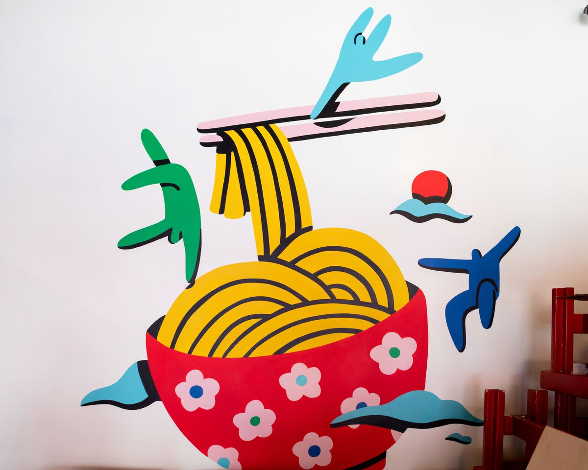 A colorful mural of a bowl of noodles inside Huangcheng Noodle House