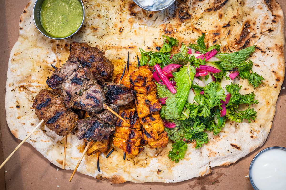 Lamb loin, ground beef and lamb kefta, and chile-spiced chicken shawarma kebabs come with condiments, pickles, and herbs.