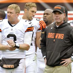 Cleveland Browns quarterback Brandon Weeden (3) stands on the sidelines with head coach Pat Shurmur in the final moments of a 24-14 loss to the Cleveland Browns in an NFL football game on Sunday, Sept. 23, 2012, in Cleveland.
