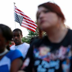 """An inverted U.S. flag, which is a recognized signal of distress, is seen the """"End of School Year Peace March and Rally"""" 