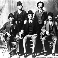 Historic Wild Bunch photo shows Harry Longabaugh, seated left, and Butch Cassidy, seated right.