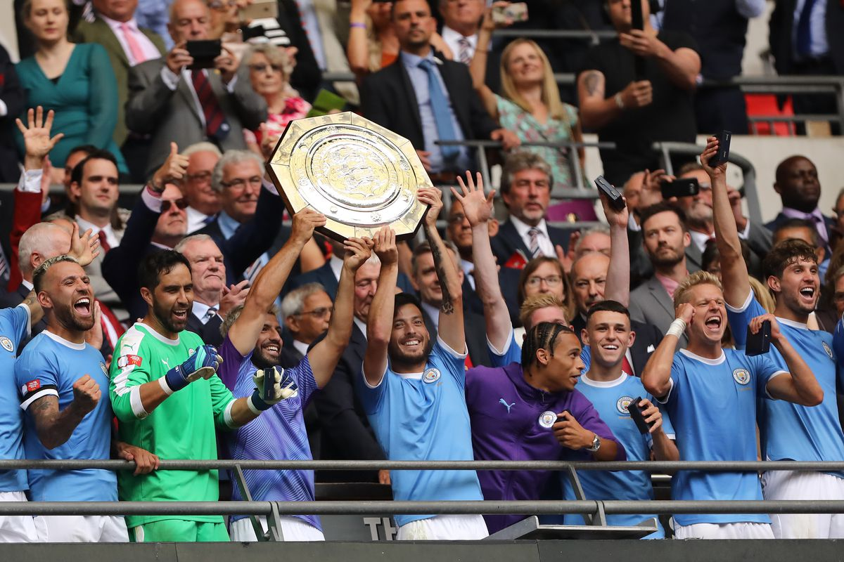 Sergio Aguero and David Silva of Manchester City are seen...