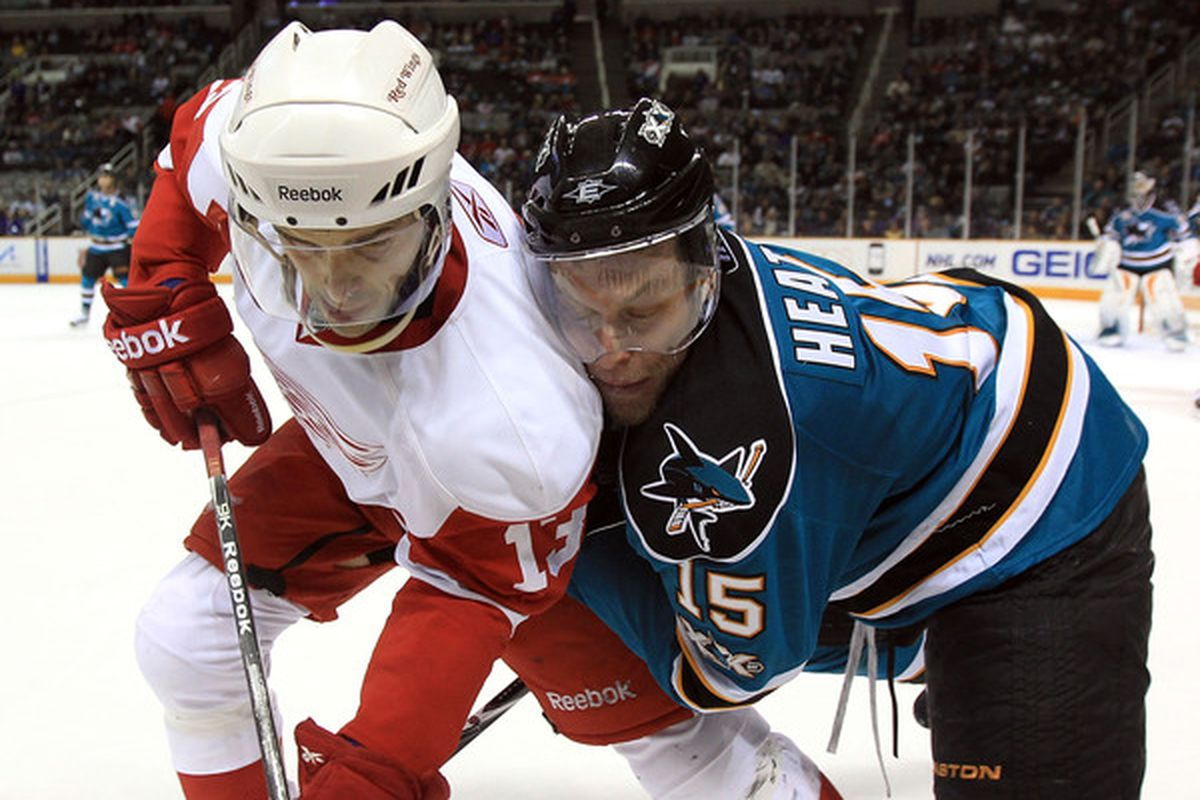 SAN JOSE CA - NOVEMBER 30:  Dany Heatley #15 of the San Jose Sharks struggles with Pavel Datsyuk #13 of the Detroit Red Wings at HP Pavilion on November 30 2010 in San Jose California.  (Photo by Ezra Shaw/Getty Images)