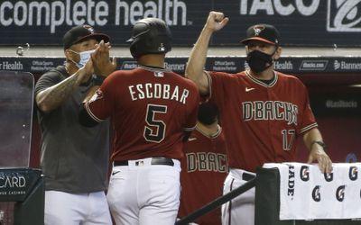 Peralta and Lovullo congratulate Escobar.
