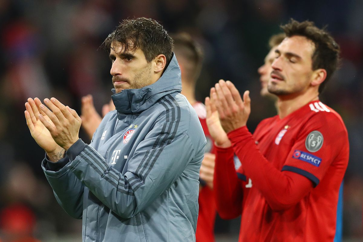 MUNICH, GERMANY - MARCH 13: Javi Martinez and Mats Hummels of Bayern Munich look dejected in defeat after the UEFA Champions League Round of 16 Second Leg match between FC Bayern Muenchen and Liverpool at Allianz Arena on March 13, 2019 in Munich, Bavaria.
