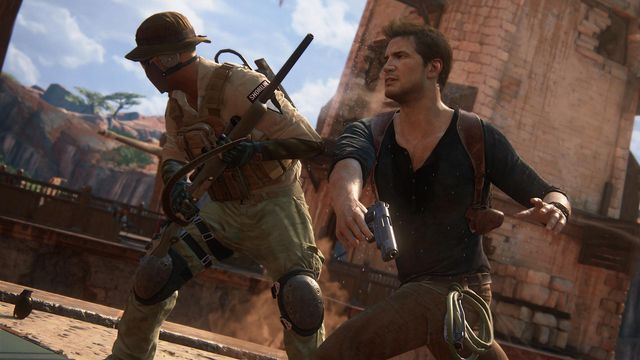 Nathan Drake punches a thug in a screenshot from Uncharted 4