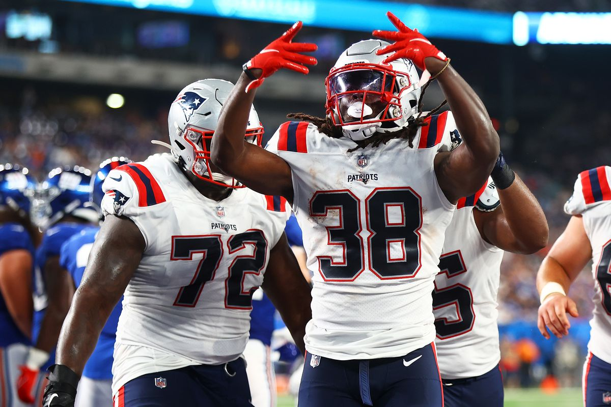 Rhamondre Stevenson #38 of the New England Patriots celebrates after rushing the ball in for a third-quarter touchdown against the New York Giants at MetLife Stadium on August 29, 2021 in East Rutherford, New Jersey.