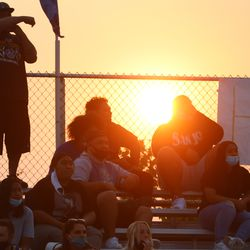 Orem spectators sit in the stand while keeping their masks on during a high school football game at Orem High School in Orem on Friday, Aug. 21, 2020.