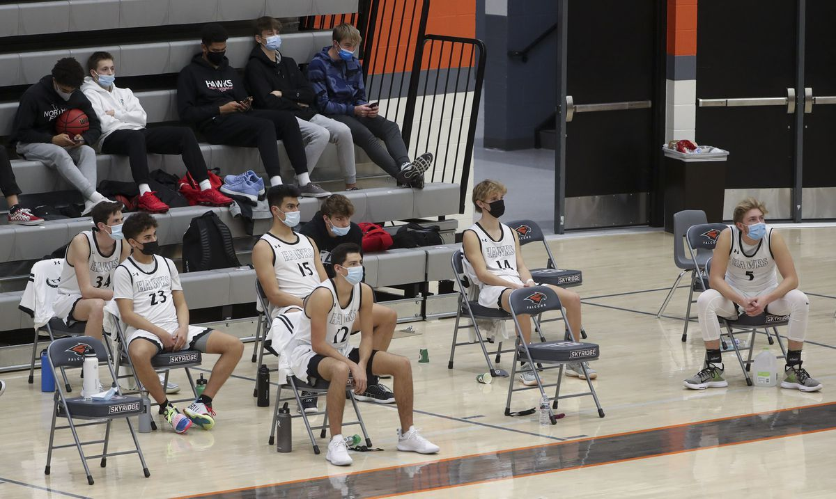 The Alta Hawks social distance on the bench during their game against Corner Canyon at Skyridge High School in Lehi on Friday, Dec. 11, 2020.