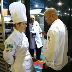 A judge talks with Utah Valley University culinary student Madeline Black during the American Culinary Federation Cook. Craft. Create. national convention on July 8-13 in Orlando, Florida. Black was named the National Student Chef of the Year after making a winning dish including truffle-scented duck roulade finished in duck fat, with Utah honey lacquered duck thigh-riblet.