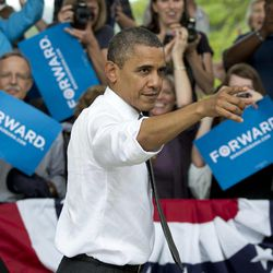 President Barack Obama points to the crowd as he leaves a campaign event at Eden Park's Seasongood Pavilion, Monday, Sept. 17, 2012, in Cincinnati, Ohio.