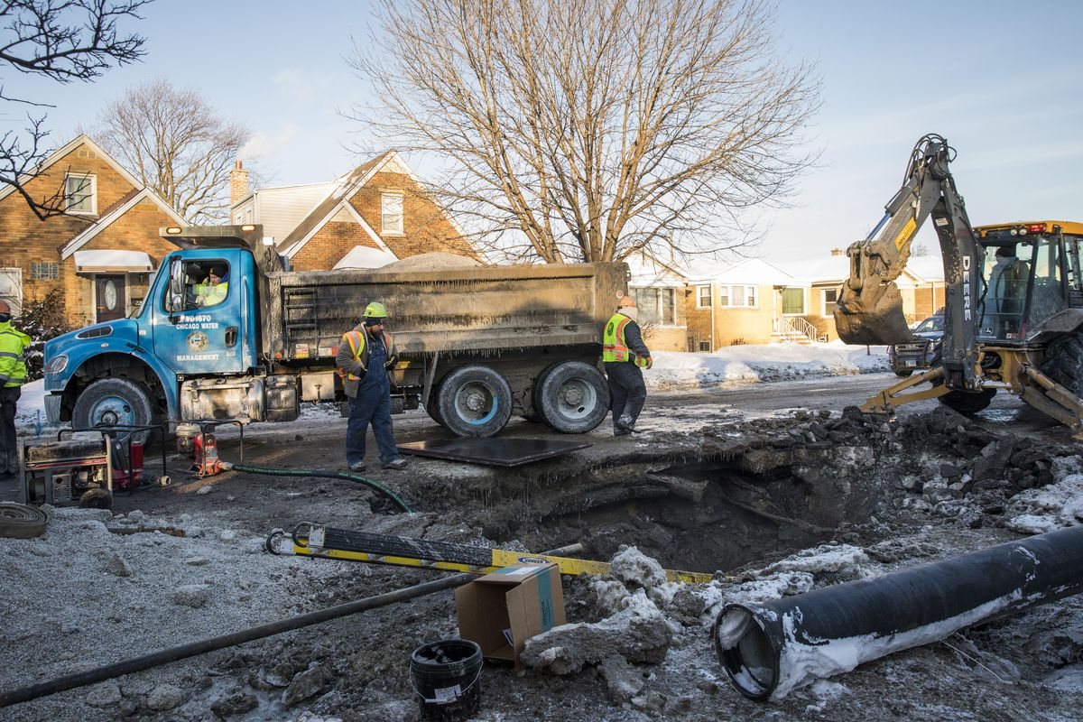 Chicago Department of Water Management employees at a water main break on the Northwest Side in January 2019.