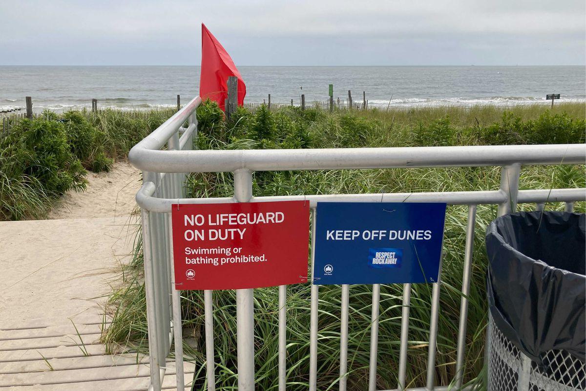 Signs near Beach 101st Street warn swimmers. Aug. 10, 2021.