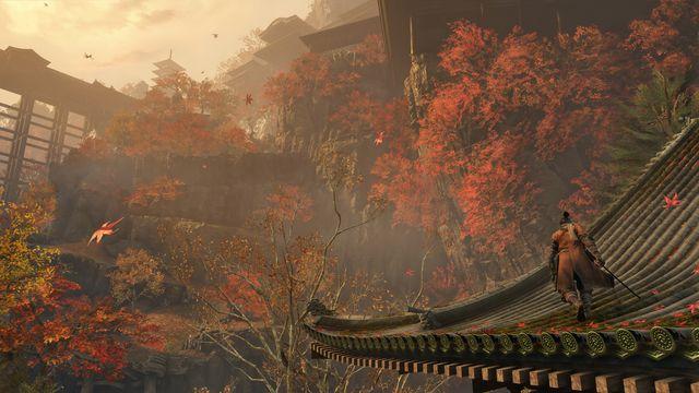 a ninja walks along a rooftop in a lush autumn landscape in Sekiro: Shadows Die Twice