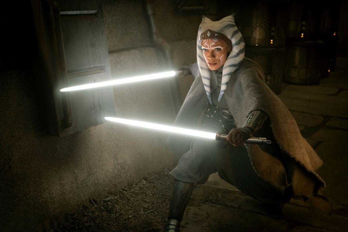 Rosario Dawson as Ahsoka Tano in The Mandalorian wielding two white lightsabers