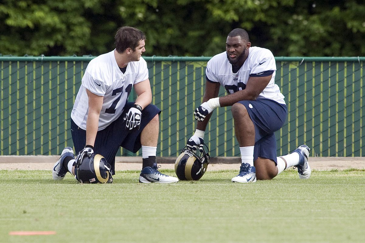 May 11, 2012; St. Louis, MO, USA; St. Louis Rams defensive tackle Michael Brockers (left) talks with defensive tackle Matthew Conrath (71) during mini camp at ContinuityX Training Center. Mandatory Credit: Jeff Curry-US PRESSWIRE