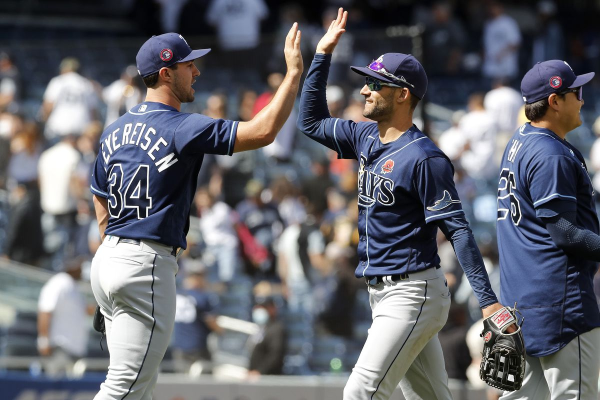 J.P. Feyereisen #34, Kevin Kiermaier #39 and Ji-Man Choi #26 of the Tampa Bay Rays celebrate after defeating the New York Yankees at Yankee Stadium on May 31, 2021 in New York City. The Rays defeated the Yankees 3-1.
