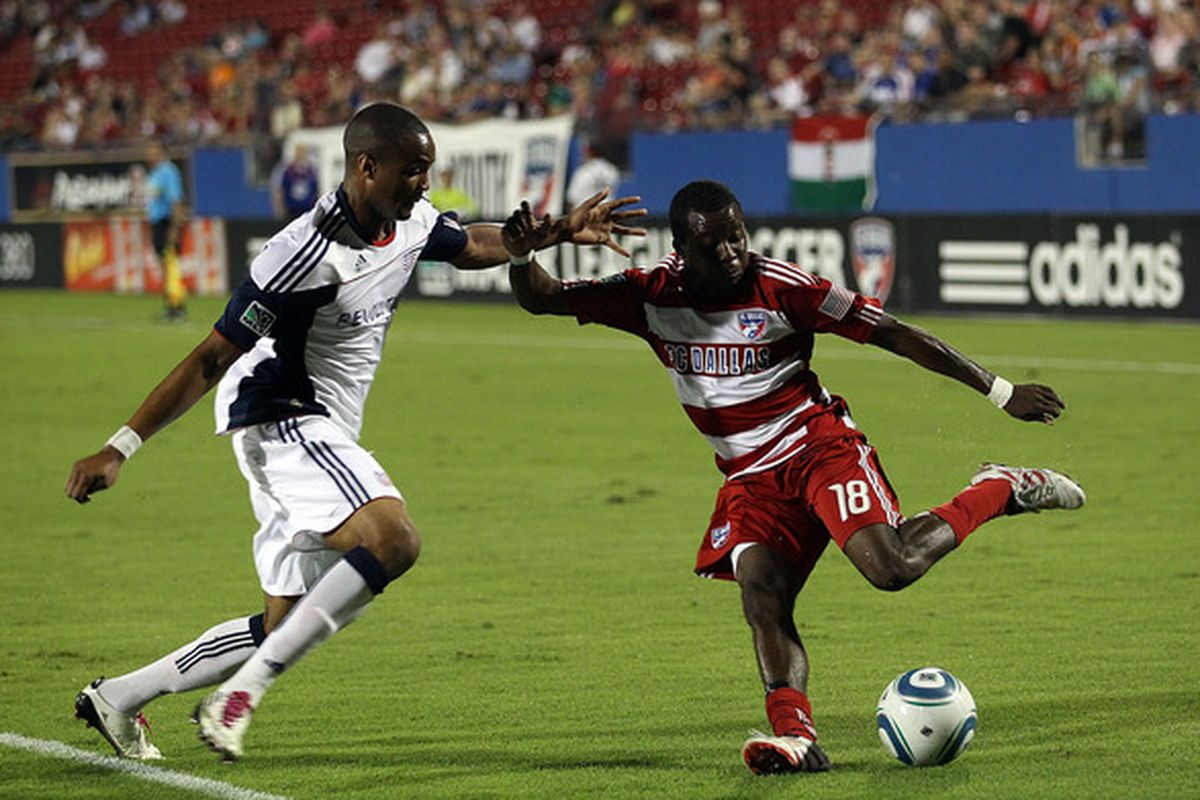 FRISCO TX - SEPTEMBER 22:  Midfielder Marvin Chavez #18 of FC Dallas dribbles the ball past Darrius Barnes #25 of the New England Revolution at Pizza Hut Park on September 22 2010 in Frisco Texas.  (Photo by Ronald Martinez/Getty Images)