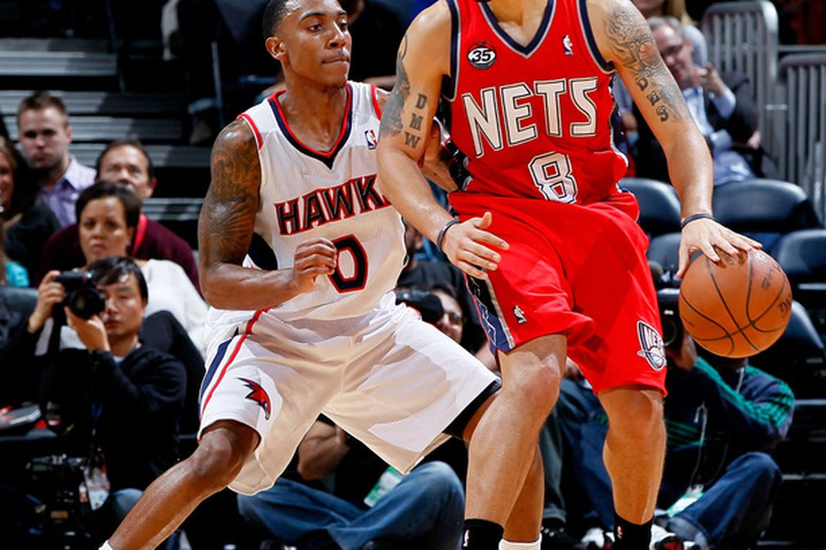 ATLANTA, GA - DECEMBER 30:  Jeff Teague #0 of the Atlanta Hawks defends Deron Williams #8 of the New Jersey Nets at Philips Arena on December 30, 2011 in Atlanta, Georgia.  (Photo by Kevin C. Cox/Getty Images)