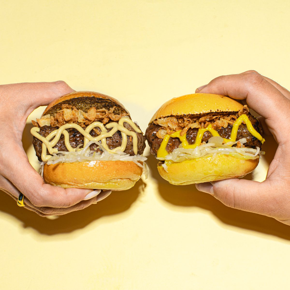 two mustard topped sausage sliders