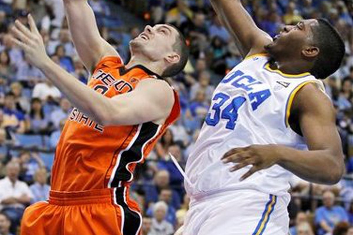 UCLA's Joshua Smith (34) blocks a shot by Oregon State's Kevin McShane (0), one of 16 shots the Bruins swatted away.  (Photo by Danny Moloshok, AP)