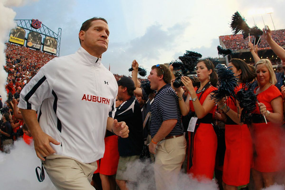 AUBURN AL - SEPTEMBER 18:  Head coach Gene Chizik of the Auburn Tigers leads his team onto the field to face the Clemson Tigers at Jordan-Hare Stadium on September 18 2010 in Auburn Alabama.  (Photo by Kevin C. Cox/Getty Images)