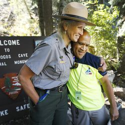 Keenan Adcock, 51, is hugged by ranger Nancy Thoreson prior to hiking the Timpanogos Cave National Monument trail for the 100th time this season on Wednesday, Aug. 31, 2016, in American Fork. Adcock underwent open-heart surgery to replace an aortic valve. The 1 ½ mile trail ascends 1,000 feet to the cave entrance.