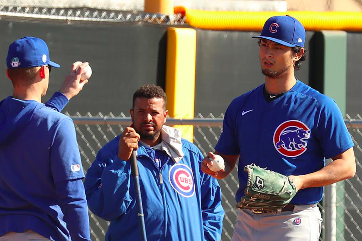 Yu Darvish working with pitching coach Tommy Hottovy earlier this spring.