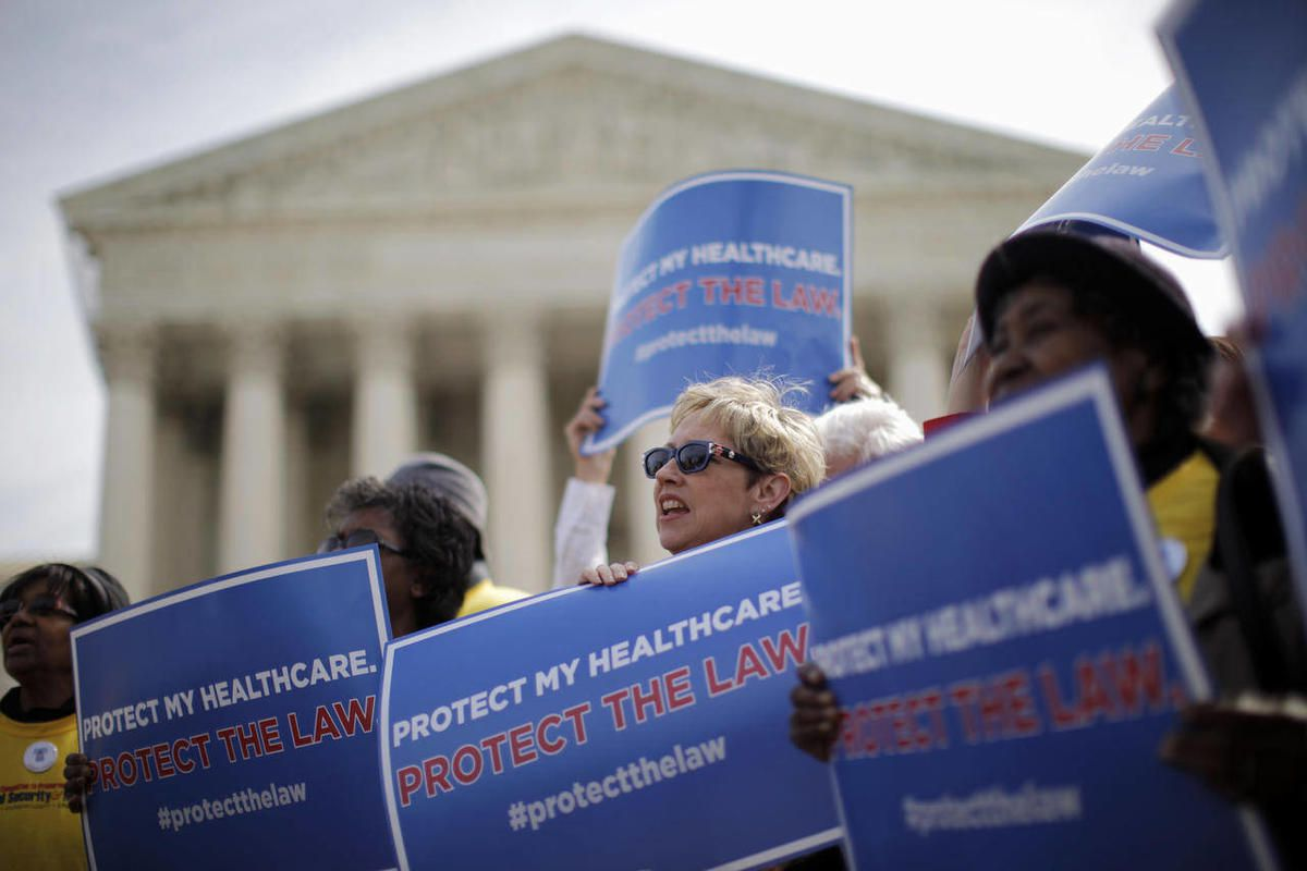 FILE - In this March 28, 2012 file photo, supporters of health care reform rally in front of the Supreme Court in Washington on the final day of arguments regarding the health care law signed by President Barack Obama. Congressional budget analysts are no