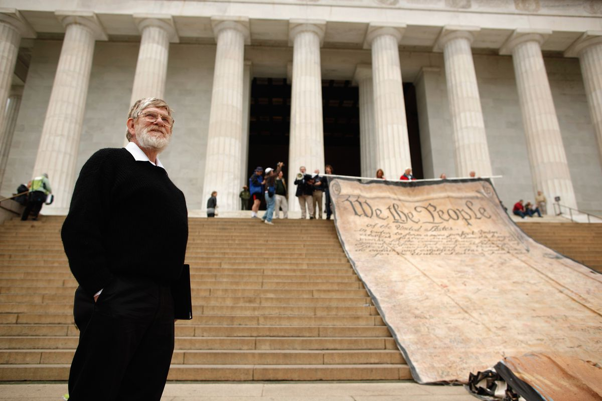 Activists protest the Citizens United decision in front of the Lincoln Memorial.