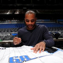 Orlando Magic guard Jameer Nelson signs one of his jerseys during the internal team autograph session on Monday, November 26.  All autographed items will be distributed back into the Central Florida community.