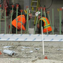 1:03 p.m. Working on the exterior bleacher wall on Sheffield -