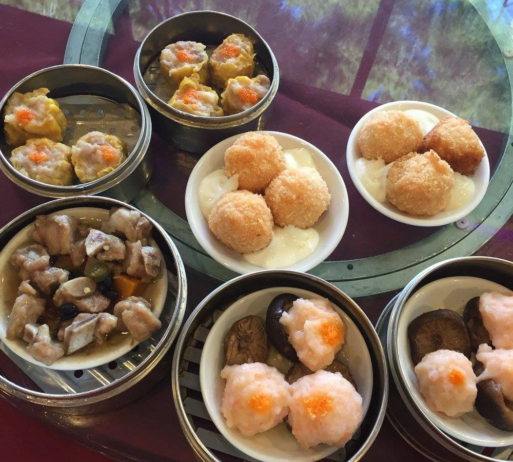 Seven baskets filled with dim sum dishes