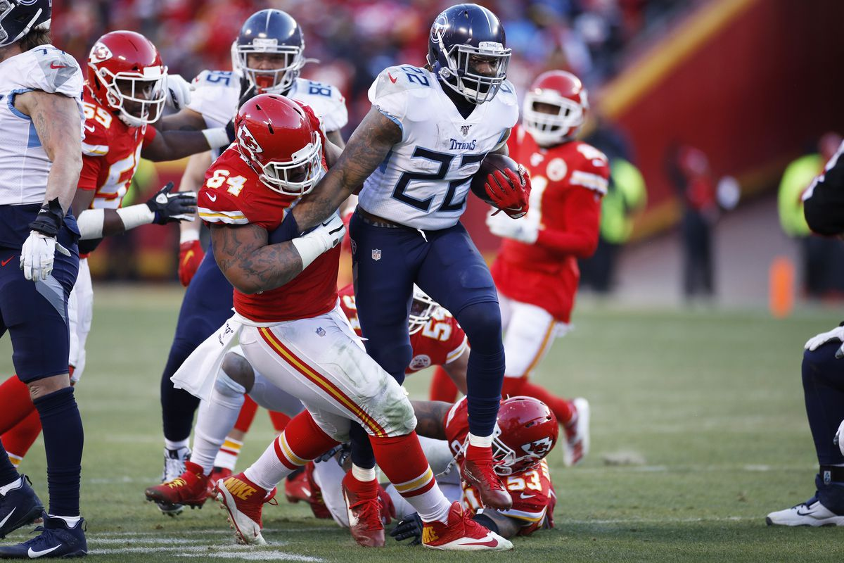 Mike Pennel of the Kansas City Chiefs tackles Derrick Henry of the Tennessee Titans during the AFC Championship game at Arrowhead Stadium on January 19, 2020 in Kansas City, Missouri. The Chiefs defeated the Titans 35-24.