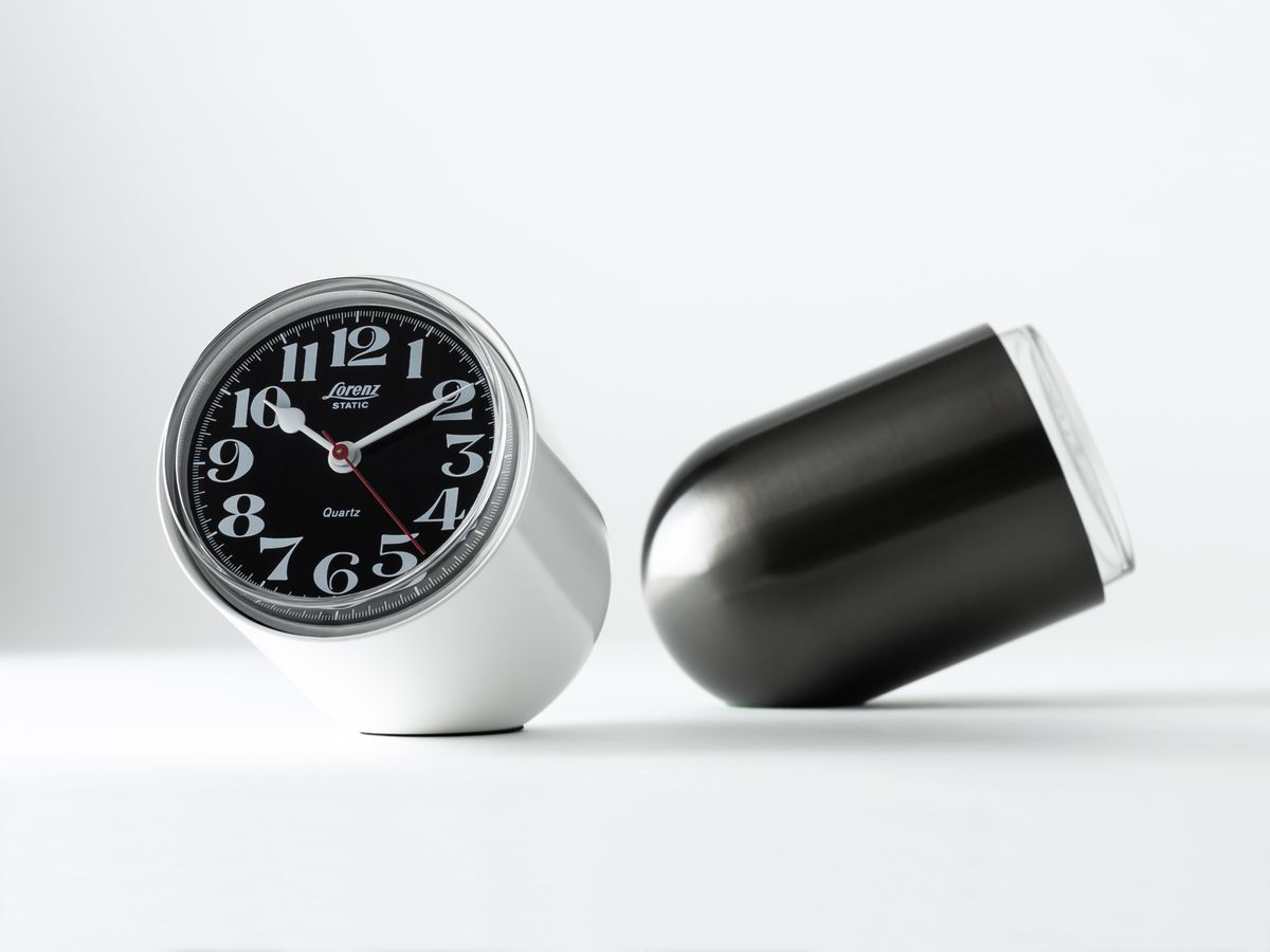 Two clocks, one silver and one black.